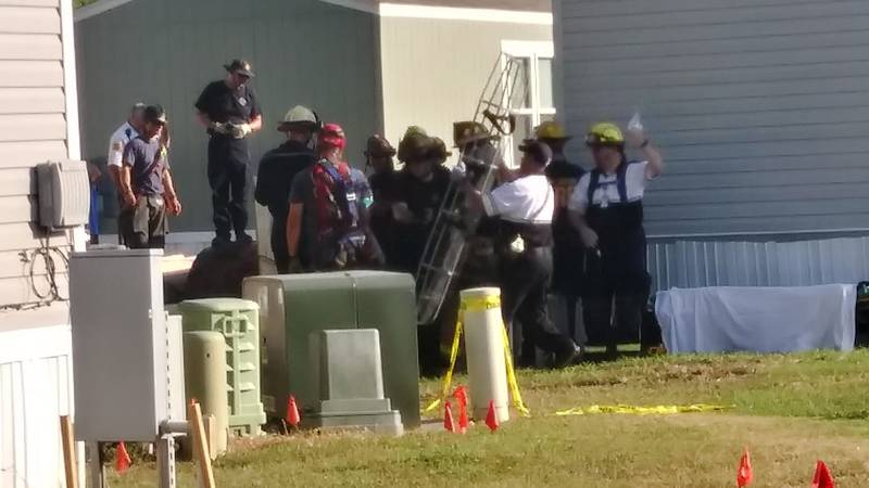 Rescue crews are working to free a man trapped in a trench in Hutchinson.