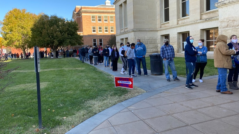 The line of early voters wrapped around the Sedgwick County Courthouse Monday morning, ahead of...