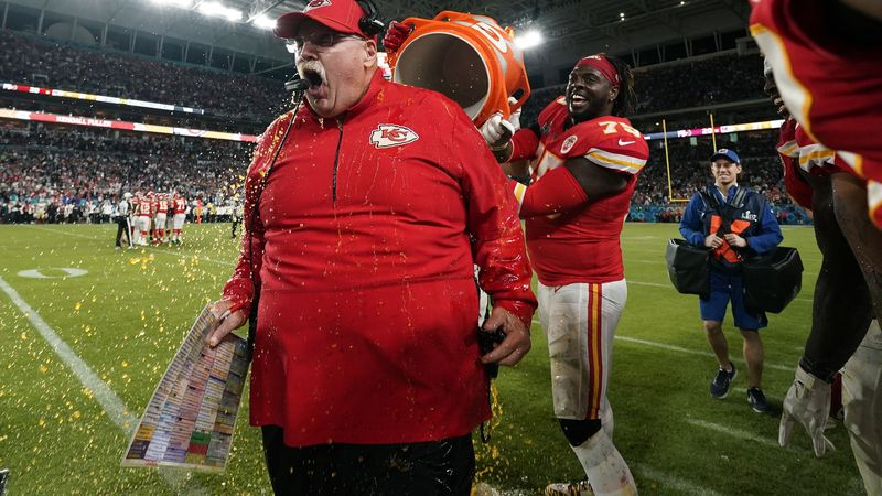 Kansas City Chiefs head coach Andy Reid reacts after being doused during the second half of...