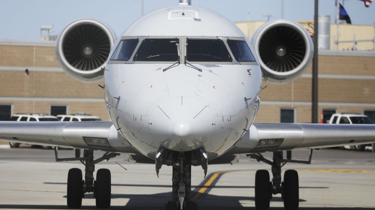 A plane sits on the tarmac at Salt Lake City International Airport Tuesday, April 7, 2020, in...