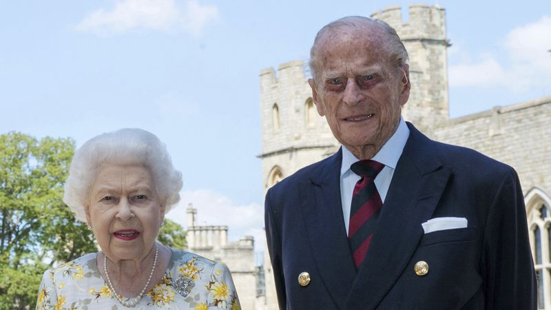 Britain's Queen Elizabeth II and Prince Philip the Duke of Edinburgh pose for a photo on June...