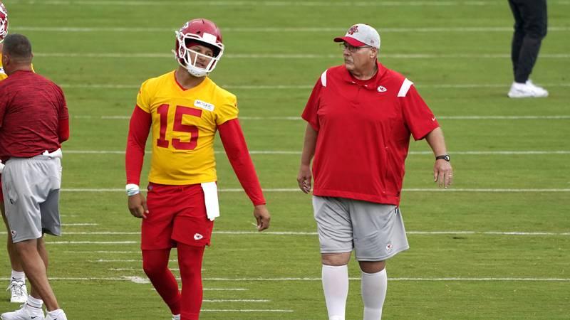FILE - Kansas City Chiefs quarterback Patrick Mahomes (15) and head coach Andy Reid talk during...