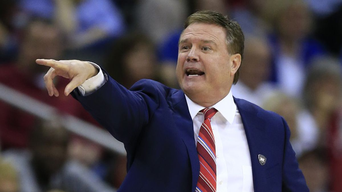 Kansas head coach Bill Self directs his team during the first half of an NCAA college...
