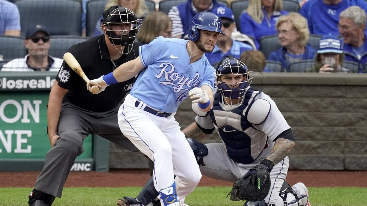 Kansas City Royals' Andrew Benintendi hits an RBI single during the fifth inning of a baseball...