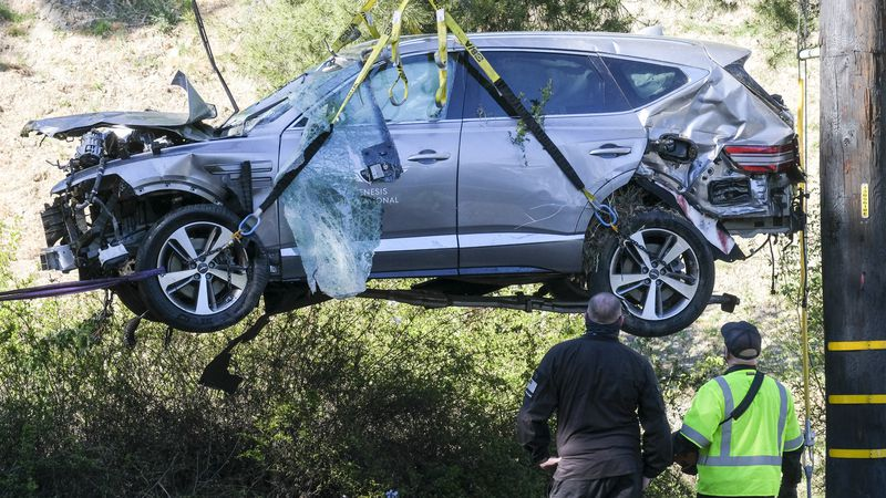 In this Feb. 23, 2021, file photo, a crane is used to lift a vehicle following a rollover...