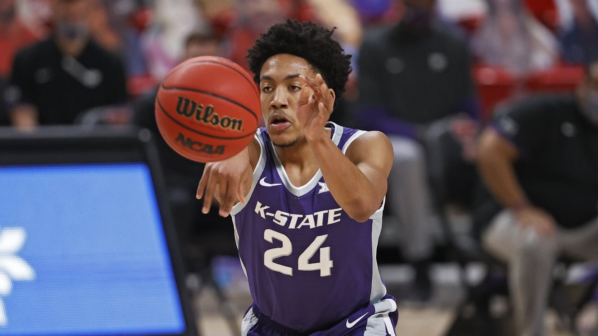 Kansas State's Nijel Pack (24) passes the ball during the first half of an NCAA college...