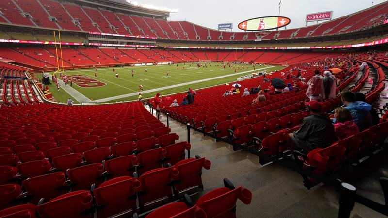FILE - In this Aug. 29, 2020, file photo, fans watch the Kansas City Chiefs during NFL football...