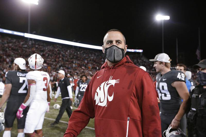 Washington State coach Nick Rolovich walks on the field after the team's NCAA college football...
