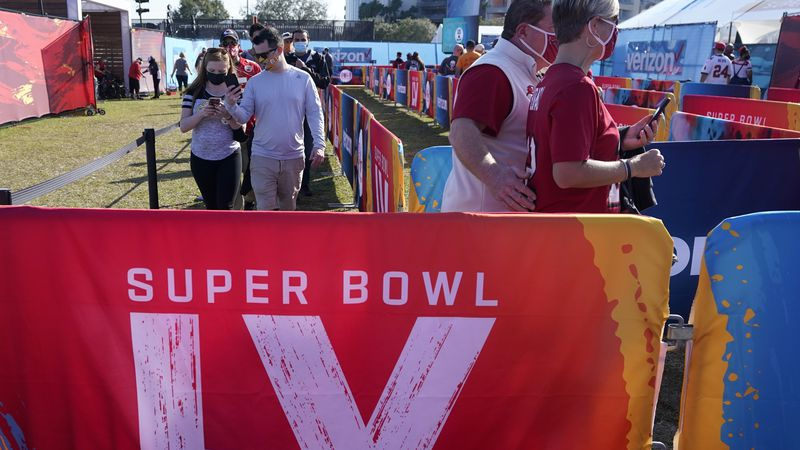 Fans arrive at Raymond James Stadium before the NFL Super Bowl 55 football game between the...