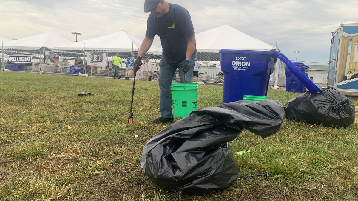 Don McGlinn, with the Cleaning Up company, was picking up items on the grounds of the Kicker...