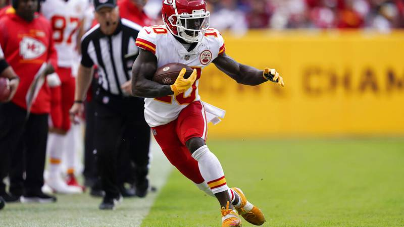Kansas City Chiefs wide receiver Tyreek Hill (10) running with the ball during the second half...