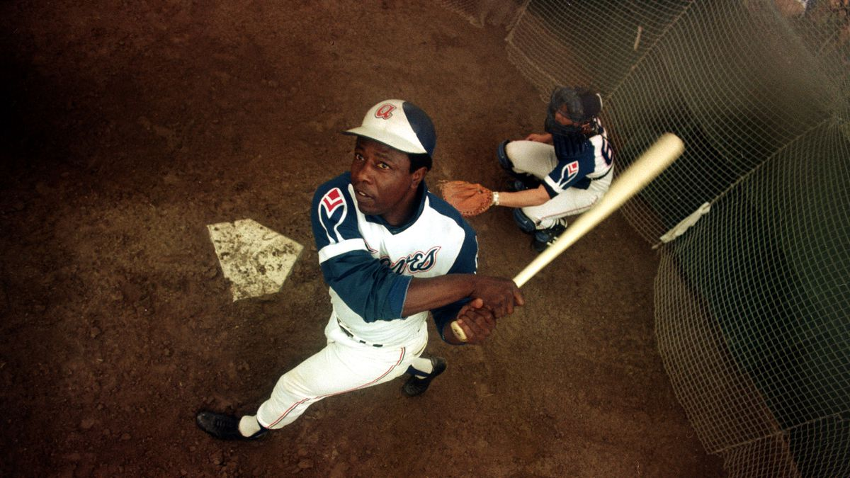 In this March 1974 file photo, Atlanta Braves outfielder Hank Aaron swings a bat at home plate...