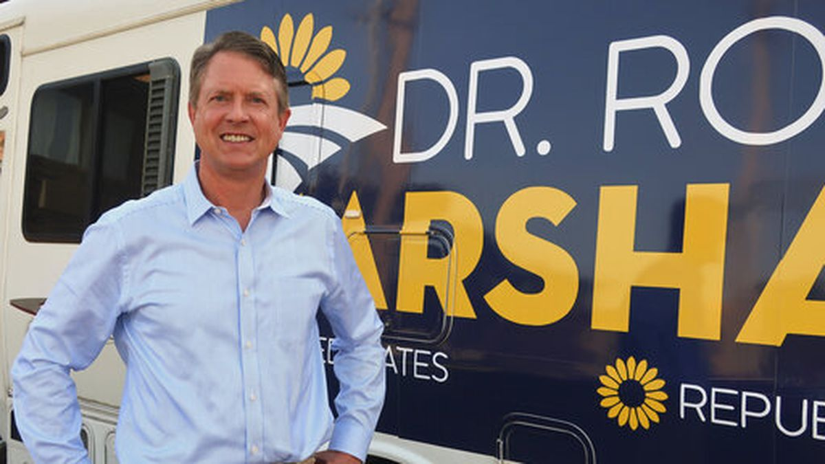 In this Thursday, Sept. 5, 2019 photo, U.S. Rep. Roger Marshall, R-Kan., stands outside an RV he uses in traveling across the state to events after an Associated Press interview in Topeka, Kansas. The two-term western Kansas congressman is running for the U.S. Senate. (AP Photo/John Hanna)