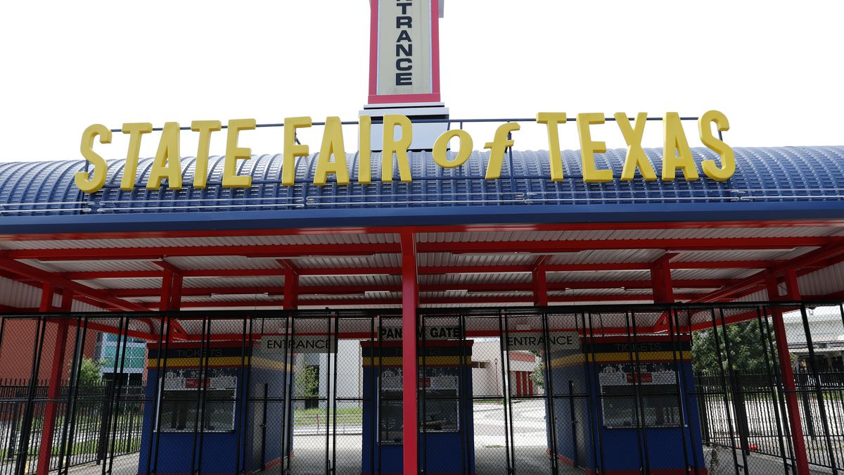 The entrance to Fair Park sits locked in Dallas, Tuesday, July 7, 2020. The State Fair of Texas has announced the 2020 event has been canceled due to COVID-19. (AP Photo/LM Otero)