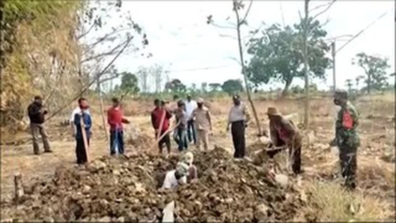 Indonesia is punishing people who violate its mask mandate by having them dig graves for...
