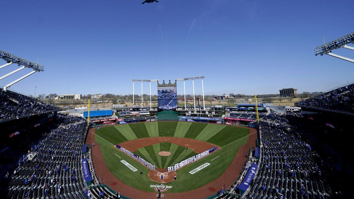 A B-2 Stealth Bomber flies over Kauffman Stadium before a baseball game between the Kansas City...