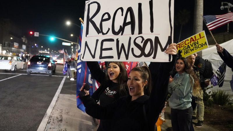In this Nov. 21, 2020, file photo, demonstrators shout slogans while carrying a sign calling...