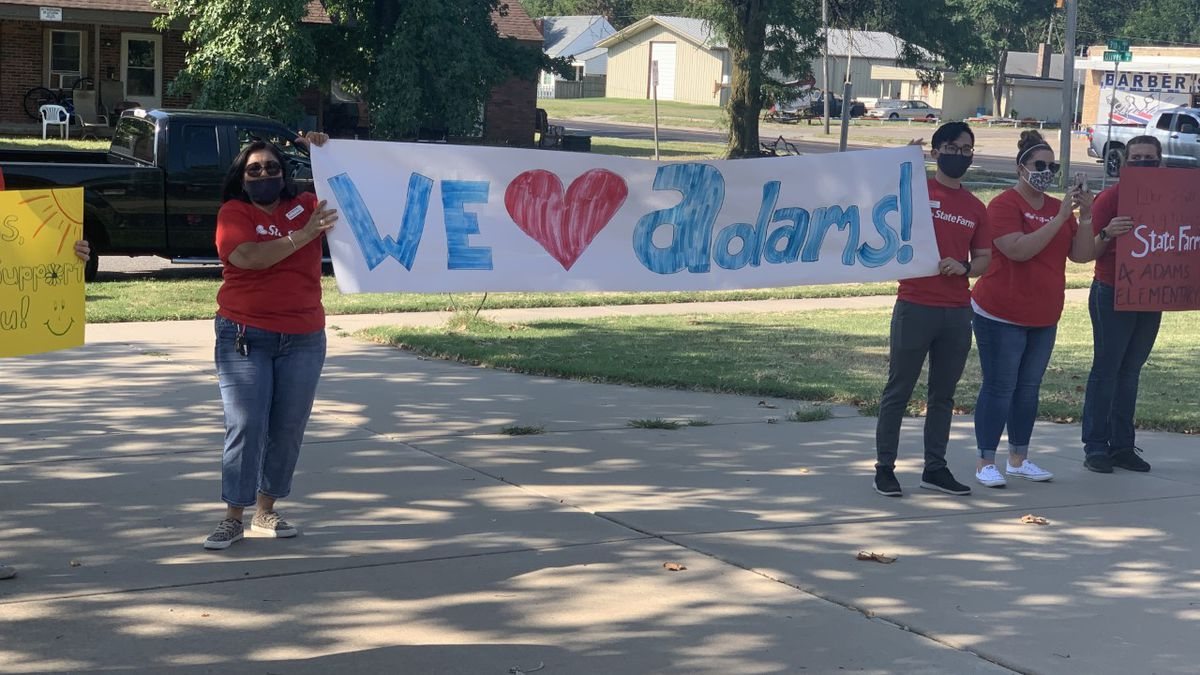 Members of Wichita's business community presented supplies and snacks Tuesday (Aug. 25) to support students, teachers and staff at Adams Elementary School.
