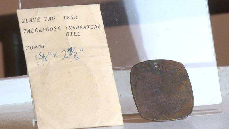A slave tag from 1858 is among artifacts at the Kansas African American Museum in Wichita.