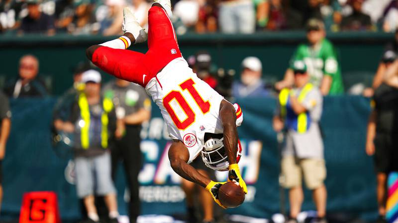 Kansas City Chiefs wide receiver Tyreek Hill (10) celebrates in the end zone after scoring a...