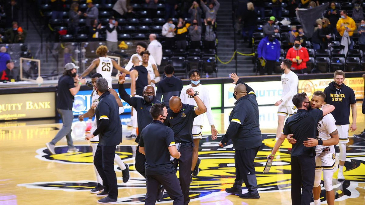 Wichita State University players and coaches celebrate after beating No. 6 Houston Thursday...