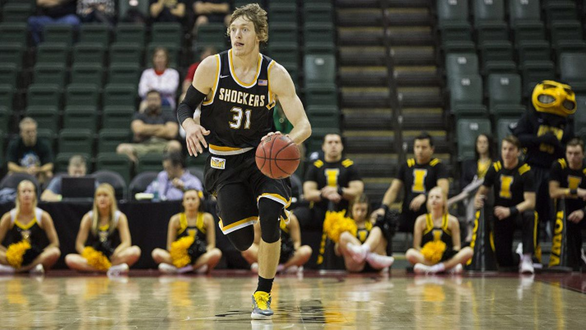 Wichita State guard Ron Baker (31) dribbles up court during the second half of an NCAA college...