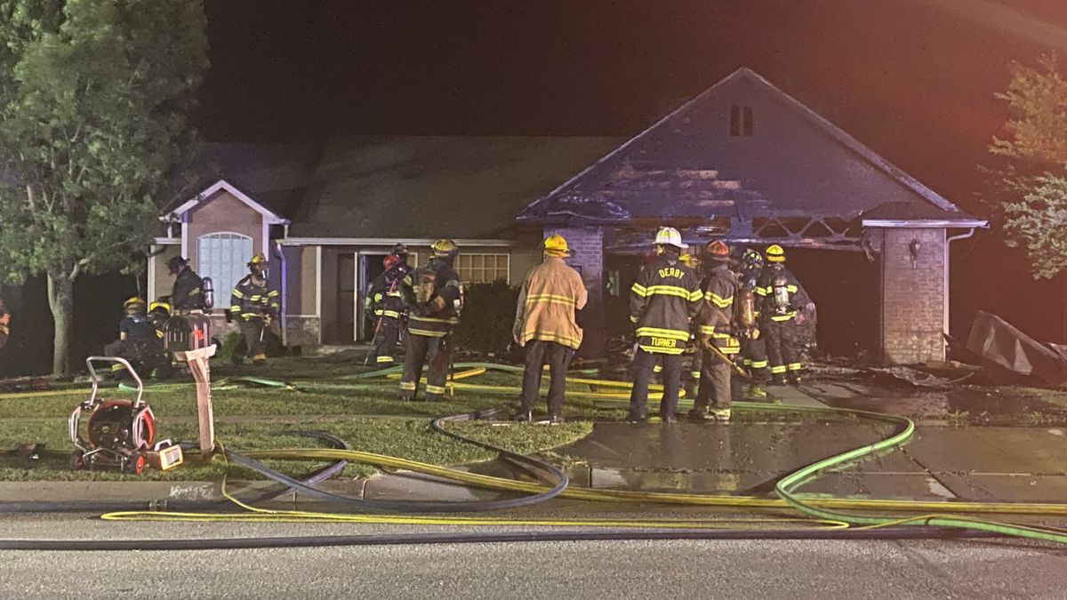 Crews respond to a house fire on Triple Creek Drive in Derby, Kan.