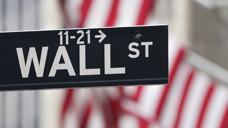 In this Nov. 23, 2020 file photo, a street sign is displayed at the New York Stock Exchange in...