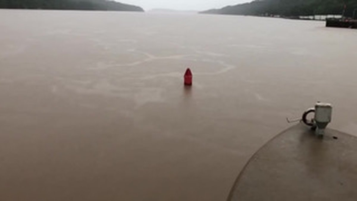 Fast-moving flood waters sink a buoy at the Dardanelle Dam. / Source: AR Army Corps of...