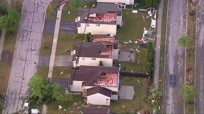 An aerial view shows widespread damage to homes in suburban Chicago.