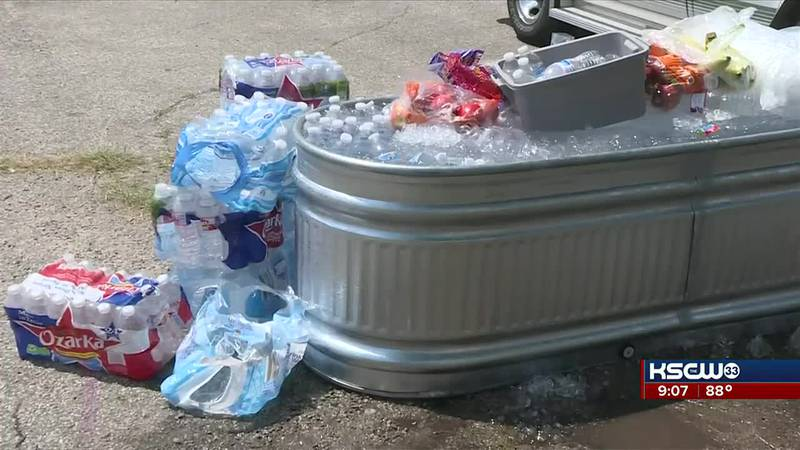 Woman helps those in need of water in this heat