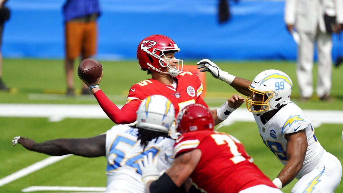 Kansas City Chiefs quarterback Patrick Mahomes throws under pressure agains the Los Angeles...