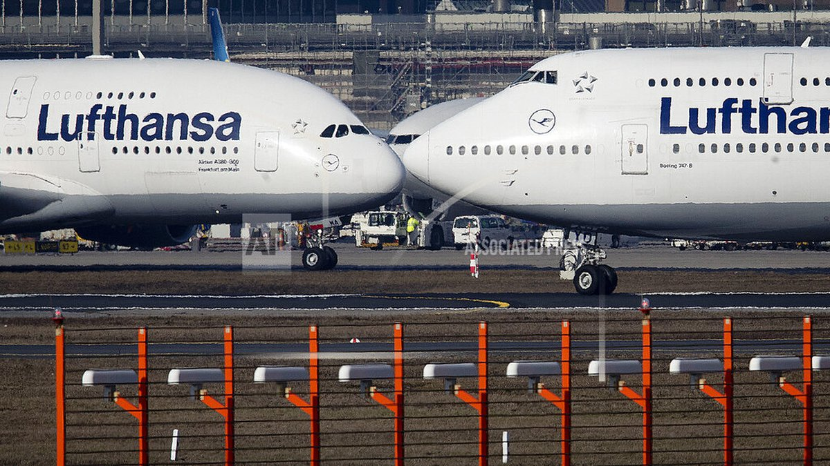 FILE - In this Feb.14, 2019 file photo, an Airbus A380, left, and a Boeing 747, both from...