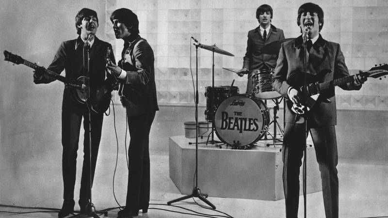 FILE - The Beatles are seen performing, date unknown. From left to right: Paul McCartney,...