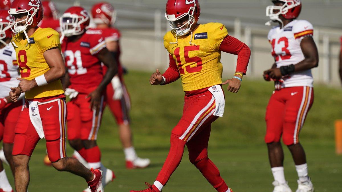 Kansas City Chiefs quarterback Patrick Mahomes (15) runs with teammates during an NFL football...