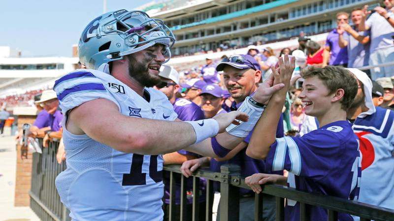Kansas State quarterback Skylar Thompson (10) is congratulated by a young fan following their...