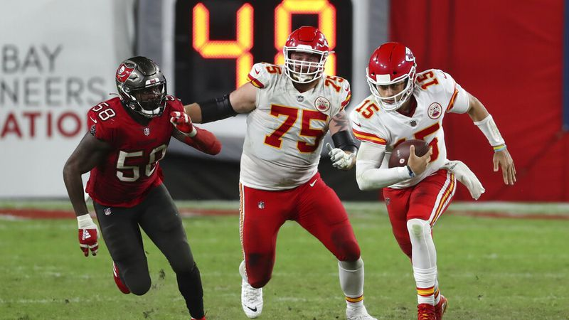 Kansas City Chiefs quarterback Patrick Mahomes (15) runs away from Tampa Bay Buccaneers outside...