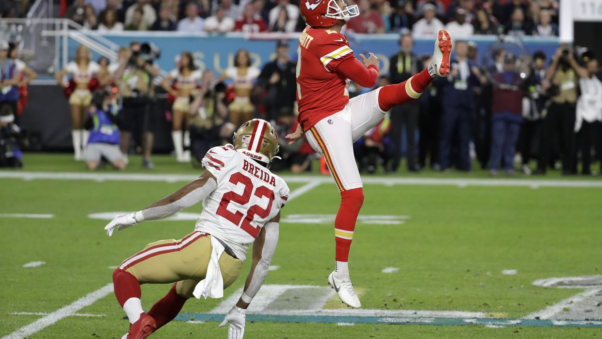 Kansas City Chiefs punter Dustin Colquitt (2) punts the ball during the first half of the NFL Super Bowl 54 football game Sunday, Feb. 2, 2020, in Miami Gardens, Fla. (AP Photo/Seth Wenig)