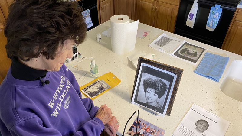 Rosemary Divilbiss (Salina) looks through photos of her sister who went missing in 1966 and was...