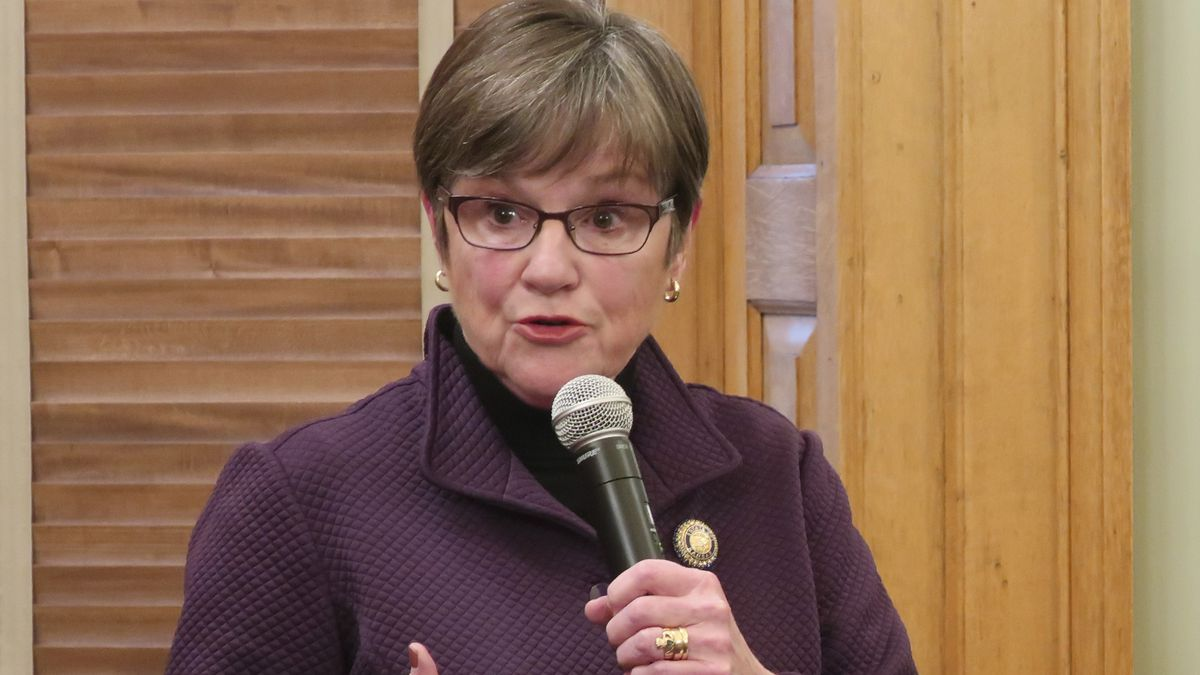 Kansas Gov. Laura Kelly answers questions from reporters about the state's response to the coronavirus outbreak, Sunday, March 15, 2020, at the Statehouse in Topeka, Kan. Kelly joined the state's education commissioner in urging schools to remain closed for the week. (AP Photo/John Hanna)