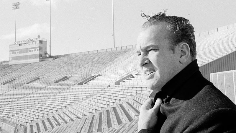 Halfback Paul Hornung of the Green Bay Packers takes a lingering look at chilly Lambeau Field...