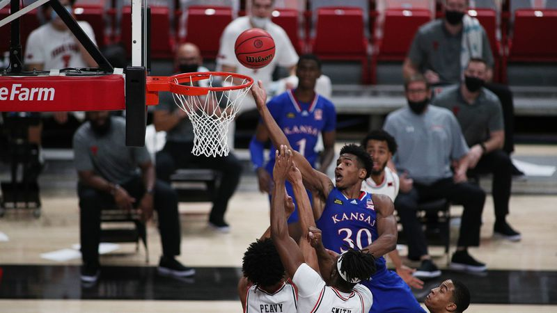 Dec 17, 2020; Lubbock, Texas, USA;  Kansas Jayhawks guard Ochai Agbaji (30) drives to the...
