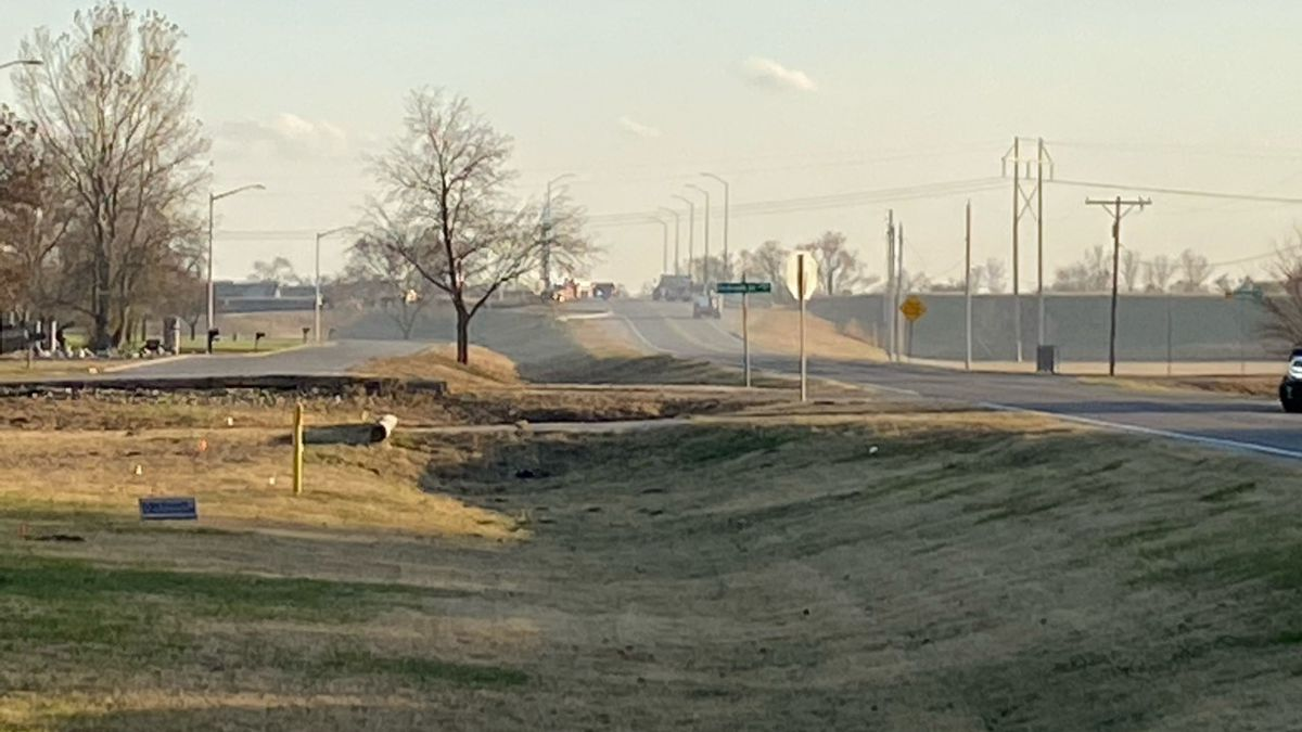Fire crews are working to put out a grass fire near East 68th Street South and South Hydraulic...
