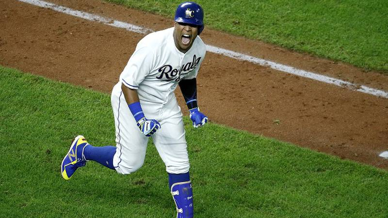 Kansas City Royals' Salvador Perez celebrates after hitting a grand slam in the ninth inning to...