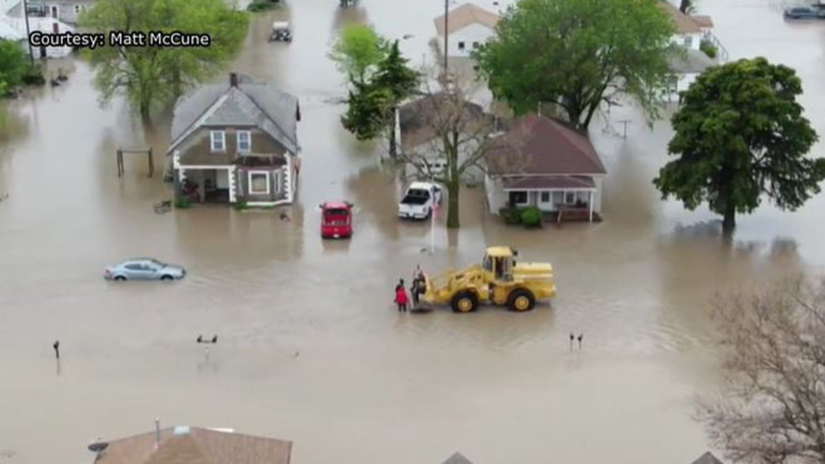 Part of the effort to save fellow Natoma residents from flooding involved use of a front loader.