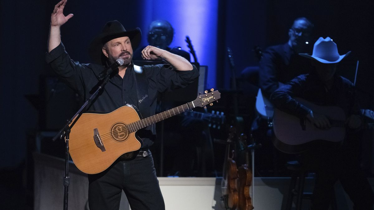 Honoree Garth Brooks performs on stage during the 2020 Gershwin Prize Honoree's Tribute Concert at the DAR Constitution Hall on Wednesday, March 4, 2020, in Washington. (Photo by Brent N. Clarke/Invision/AP)
