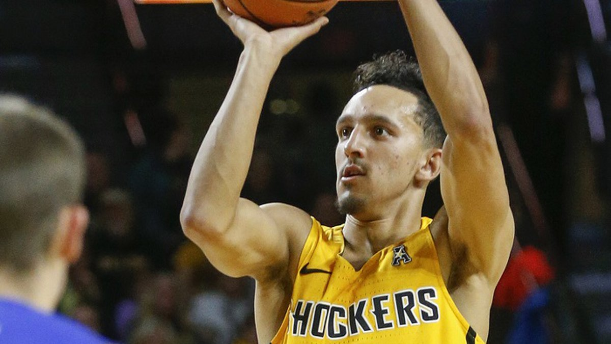 Wichita State's Landry Shamet (11) shoots for three against South Dakota State during the first...