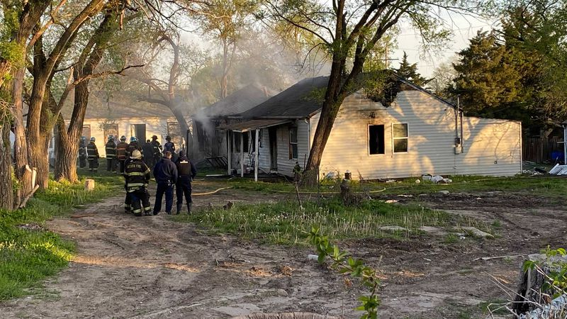 Wichita Fire crews worked to put out a house fire in south Wichita Tuesday morning.