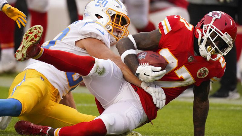 Kansas City Chiefs' Rashad Fenton is tackled by Los Angeles Chargers linebacker Cole...