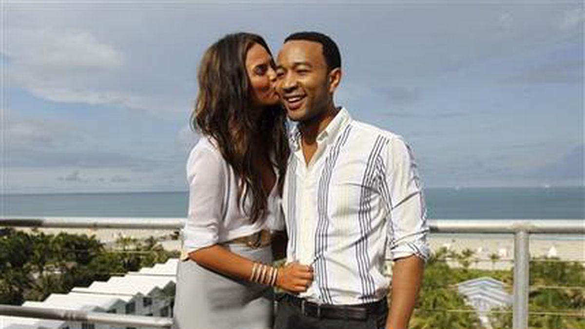 FILE - In this July 18, 2011 file photo, model Chrissy Teigen, left, and singer John Legend...